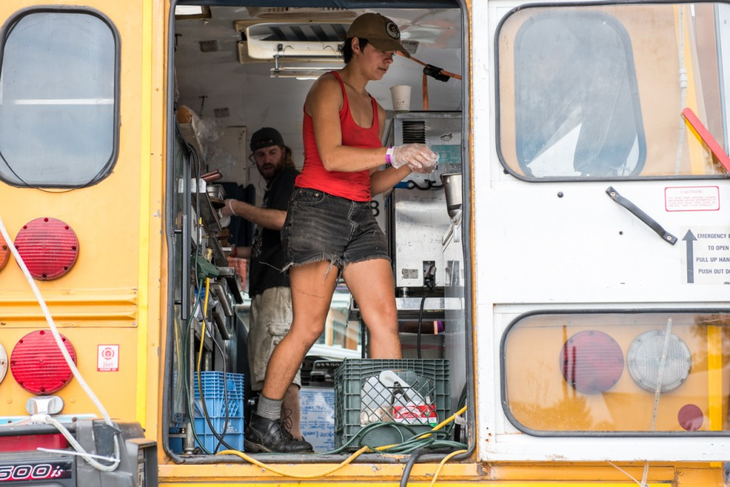 Haley Schurman (right) and Ray Burnsright (left) making burgers on the Burger Bus at the Ohio Pawpaw Festival. The festival featured lots of food, serving everything from Mexican to ice cream through out the weekend. (Carolyn Rogers/WOUB)