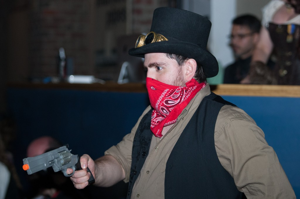 John Boban plays with a fake gun at Steampunk Rusted Rodeo. (Michael Johnson/WOUB)