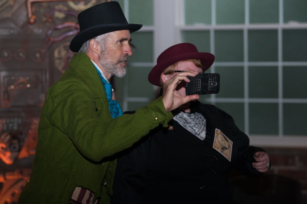 Steven Saines takes pictures at Steam Punk Rusted Rodeo. (Michael Johnson/WOUB)