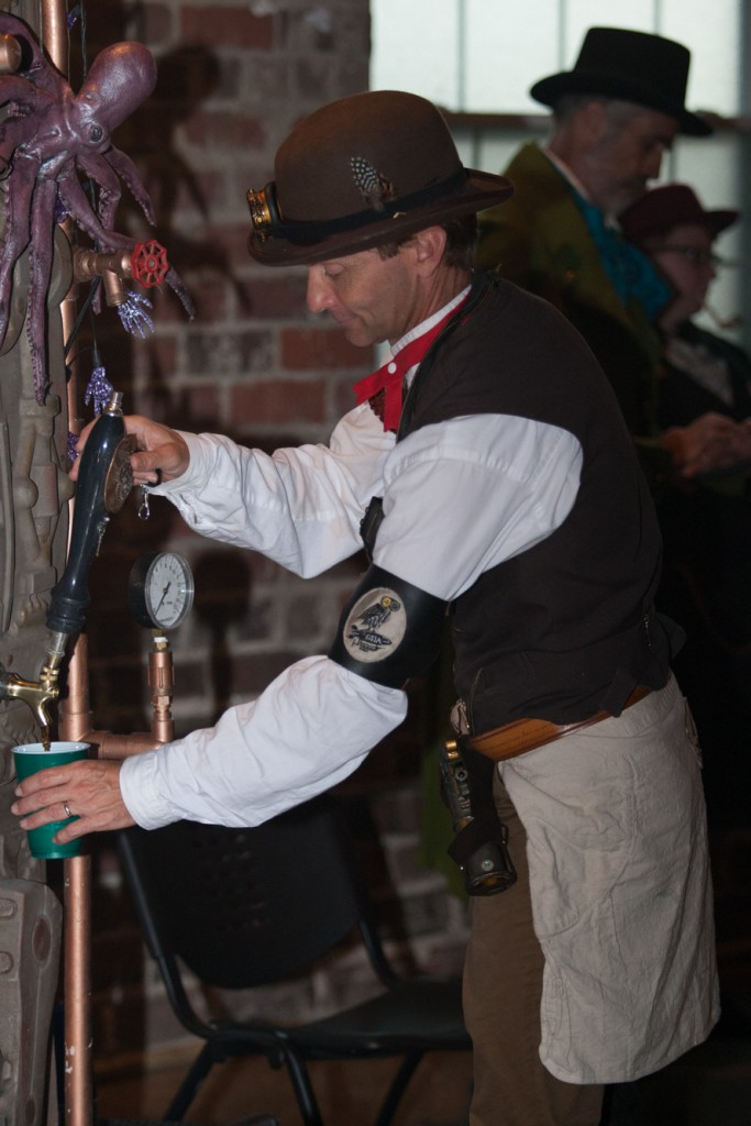 Pat Quackenbosh bartends at Steampunk Rusted Rodeo at Central Venue. (Michael Johnson/WOUB)