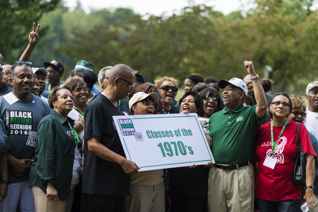 President Roderick J. McDavis cheers after the classes of the 1970's have a group portrait taken for the Black Alumni Reunion at Ohio University on September 17, 2016. (MICHAEL SWENSEN/WOUB)