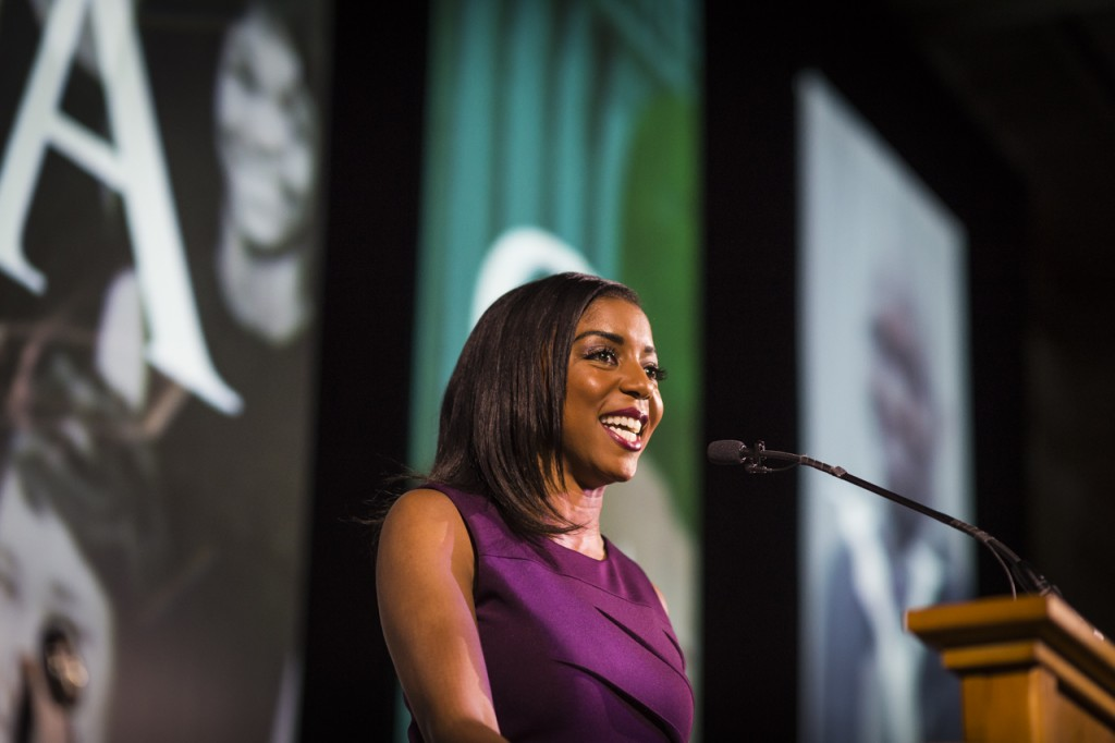 Alicia Henry, a graduate of class of 2009 gives the opening speech during the Black Alumni Reunion Gala in the Baker Ballroom at Ohio University on September 16, 2016. (MICHAEL SWENSEN/WOUB)