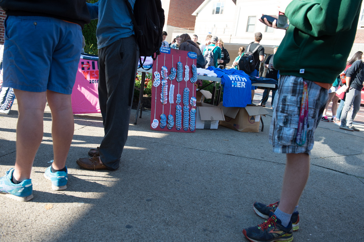 Vendors sell merchandise outside of the Alumni Gateway at Ohio University as attendees wait to get in to see former President Bill Clinton. (Robert McGraw/WOUB)