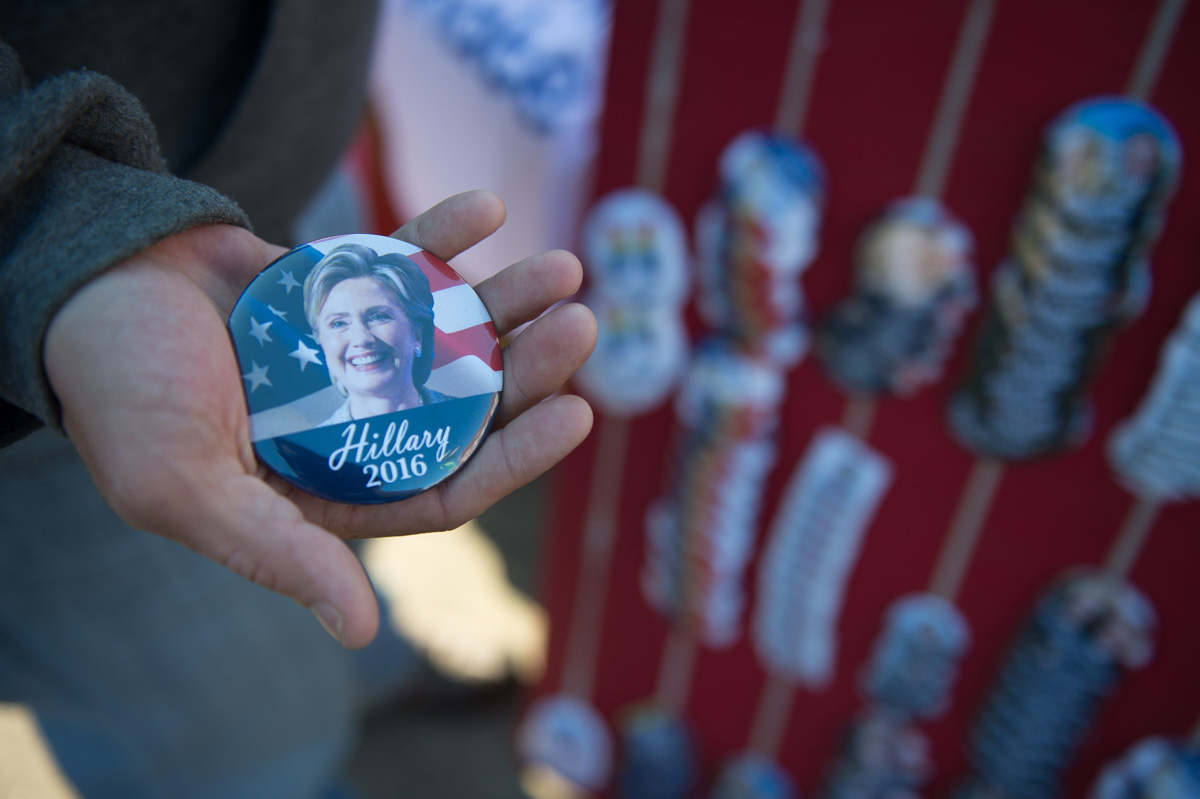 A Hillary Clinton supporter holds the button he purchased before Bill Clinton's campaign speech at Ohio University. (Robert McGraw/WOUB)