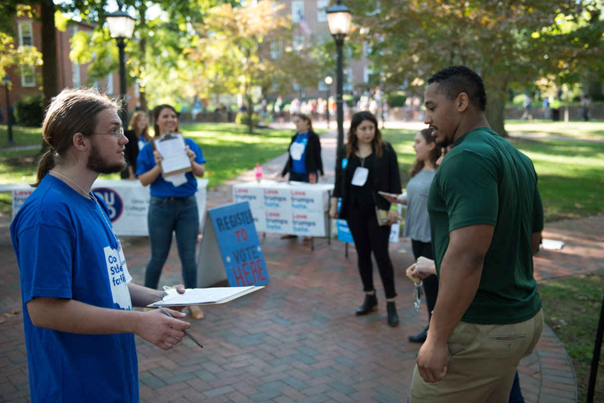 Volunteers try to make sure people are registered to vote before Bill Clinton's speech at Ohio University. (Robert McGraw/WOUB)