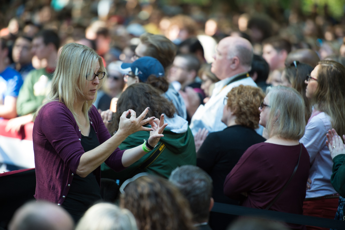 A sign language interpreter is present for the death and hard of hearing at Bill Clinton's rally at Ohio University to promote his wife Hillary Clinton. (Robert McGraw/WOUB)