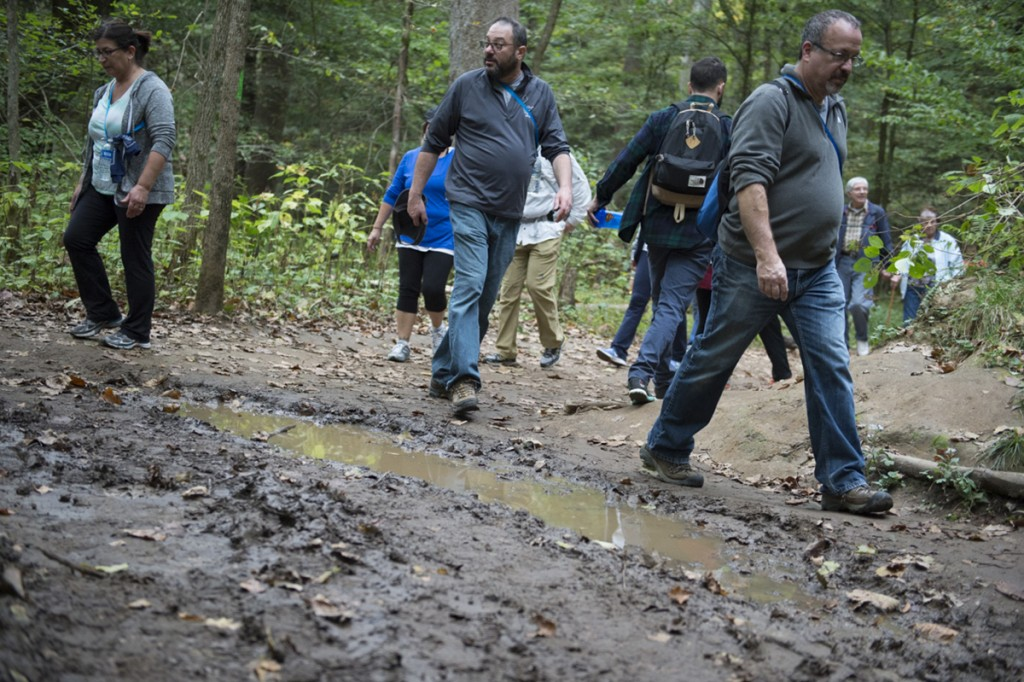 Hikers on the Grandma Gatewood's Fall Colors Hike tried to avoid the mud on the more than 5-mile hike. Attendees came from all over the world to take part in the informational nature hike in Logan, Ohio on October 15, 2016. (Robert McGraw/WOUB)