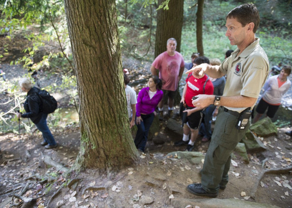 Hocking Hills Naturalist, Pat Quackenbush, leads a group of hikers on the Grandma Gatewood's Fall Colors Hike in Logan, Ohio, on October 15, 2016. (Robert McGraw/WOUB)