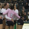 The Ohio University girls' volleyball team celebrate after scoring against Western Michigan on October 22, 2016. (Robert McGraw/WOUB)