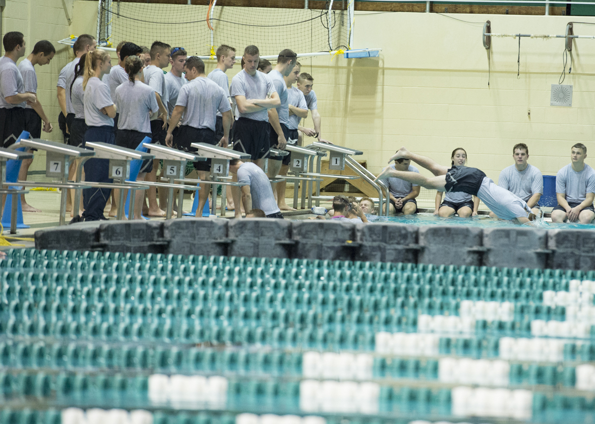 "Members of the Air Force ROTC one by one have lifesaving drills during the Water Survivor Lab held at the Ohio University Aquatic Center on October 25, 2016. ""This Water Survival Lab was a great opportunity to teach cadets the fundamentals of water safety and water survival that they may have to apply at some point in their career to complete a mission or save a life,"" said Adam Brokaw, a member of the Air Force ROTC. (Robert McGraw/WOUB)"