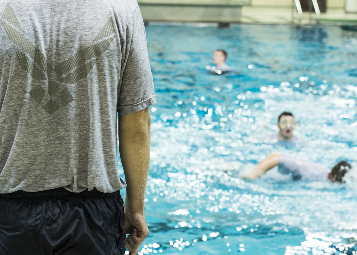 The Air Force ROTC swim back and forth during the water survival lab. (Robert McGraw/WOUB)