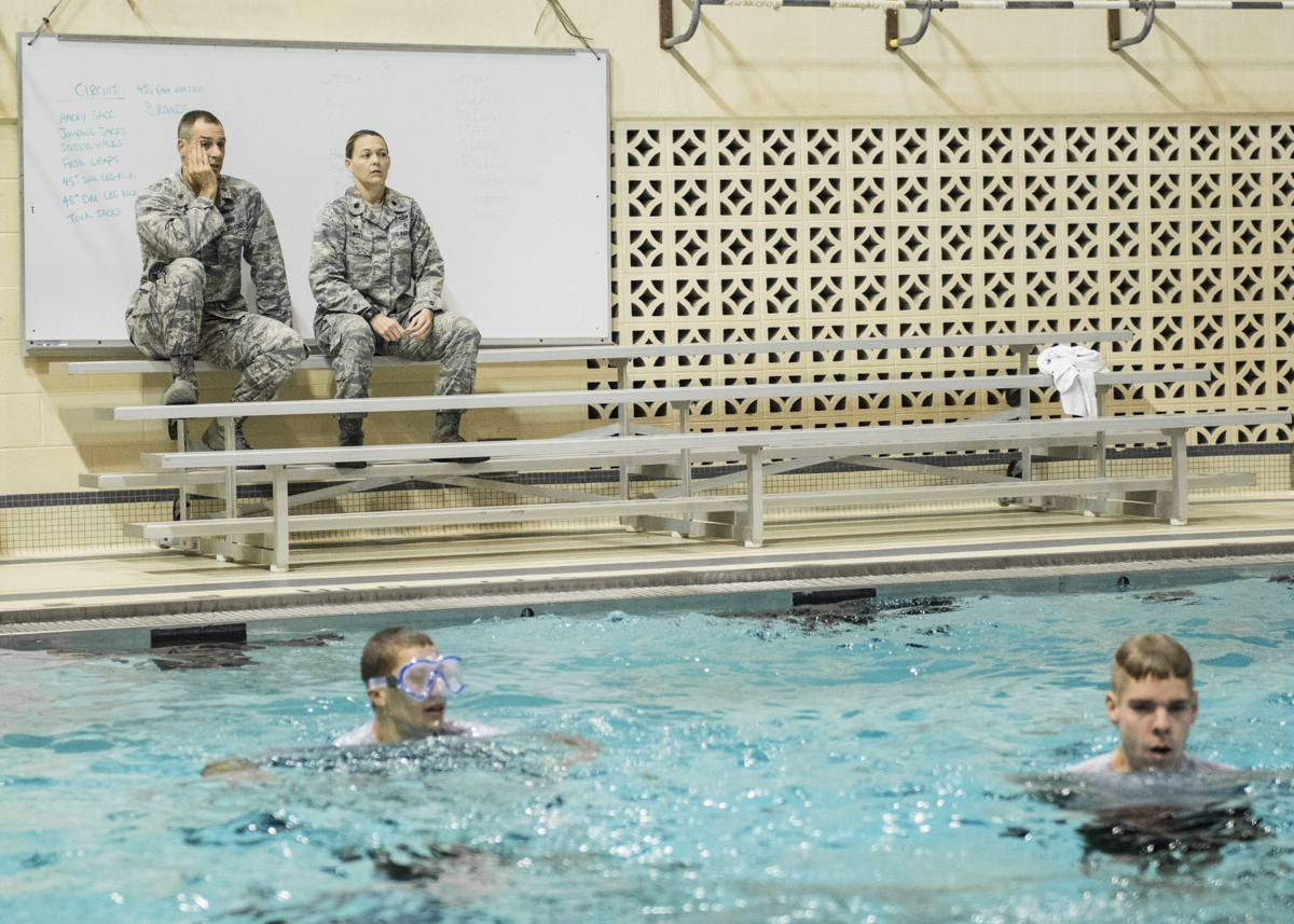 Recruiting Officer Major Johanson, left, and head of the Air Force ROTC Lieutenant Colonel Sweet, right, watch as members of the Air Force ROTC practice treading water. (Robert McGraw/WOUB)