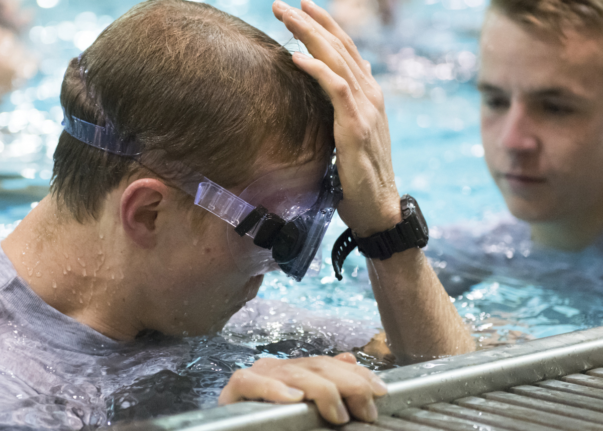 Cadet Kyle Dunlap practices his clearing, where the swimmer removes water from their goggles without taking off their masks, during the water survival training. (Robert McGraw, WOUB)