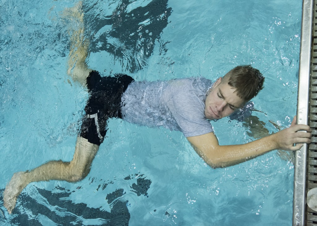 Cadet Dylan Hannon from the Air Force ROTC practices his scissor kicks during the Water Survivor Lab held at the Ohio University Aquatic Center on October 25, 2016. (Robert McGraw/WOUB)