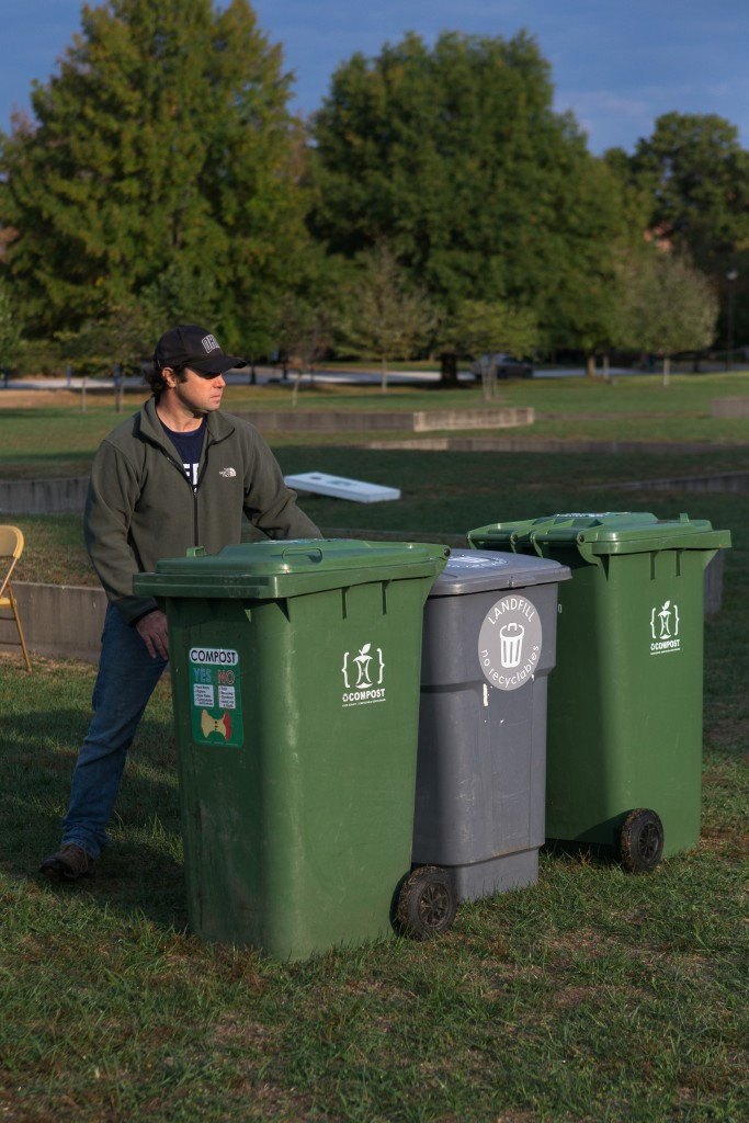 AndrewLadd, Recycling and Zero Waste Manager, sets up the bins for the GameDay Recycling Challenge at Bicentennial Park on Saturday, October 15, 2016 in Athens, Ohio. (Jorge Castillo Castro/WOUB)
