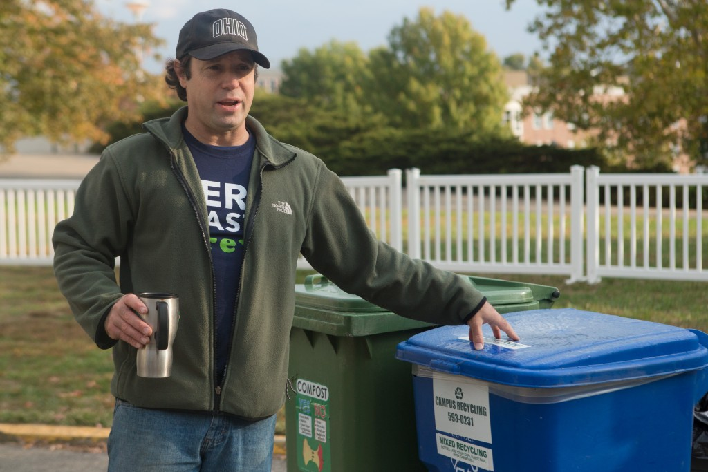 AndrewLadd, Recycling and Zero Waste Manager, sets up the bins for the GameDay Recycling Challenge at the VIP area located outside of the Ohio University Convocation Center on Saturday, October 15, 2016 in Athens, Ohio. (Jorge Castillo Castro/WOUB)