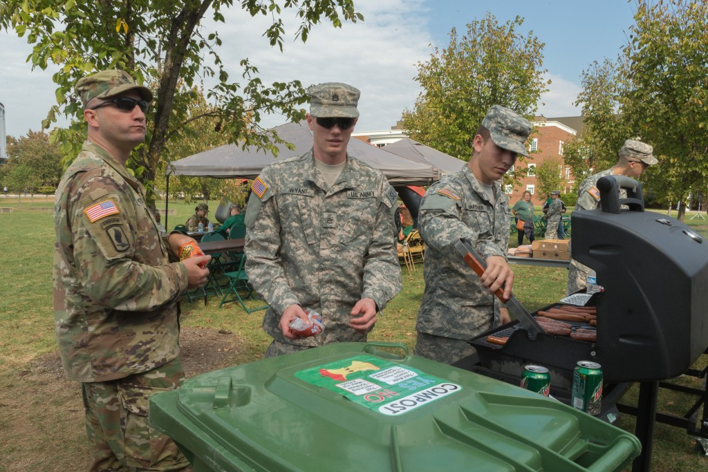 Army ROTC cadets and students at Ohio University prepare hot dogs and burgers for the attendees of the game on Saturday, October 15, 2016 in Athens, Ohio. Bins for collecting compost were located in several locations around Peden Stadium for the GameDay Recycling Challenge. (Jorge Castillo Castro/WOUB)