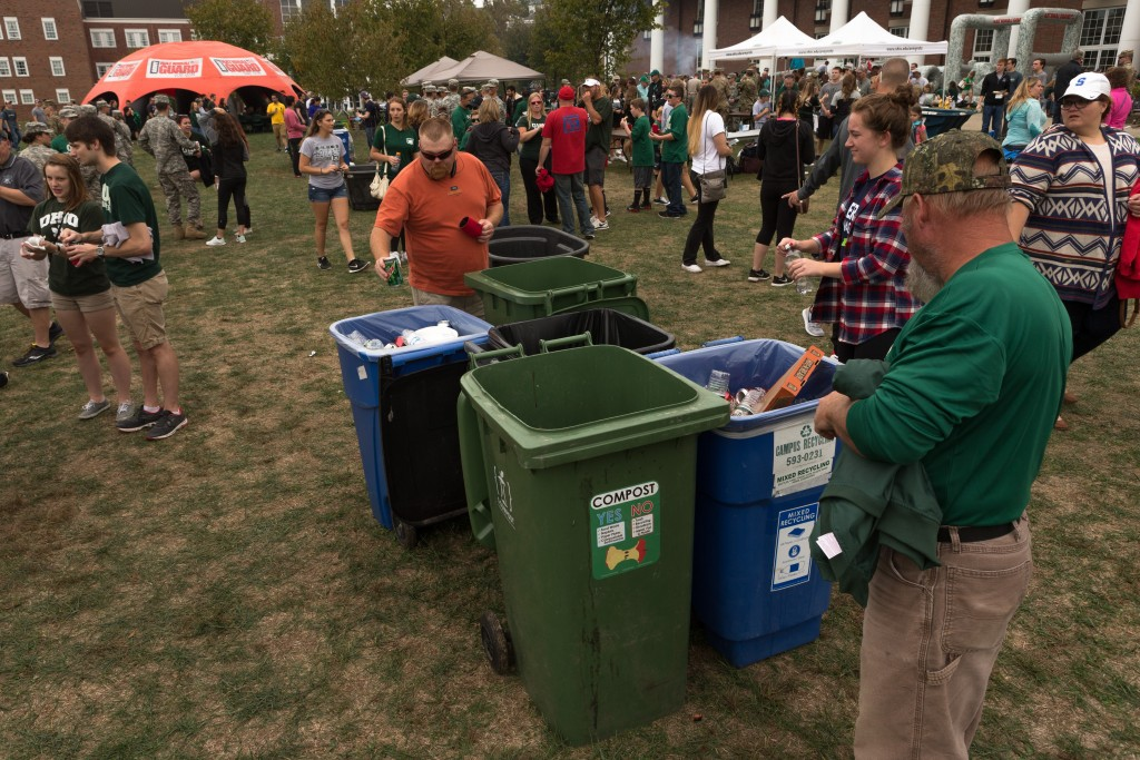 The Bobcats Fans gather before the kick off at Bicentennial Park on Saturday, October 15, 2016 in Athens, Ohio. Bins for collecting recycling, compost and garbage were located in several locations around Peden Stadium for the GameDay Recycling Challenge. (Jorge Castillo Castro/WOUB)