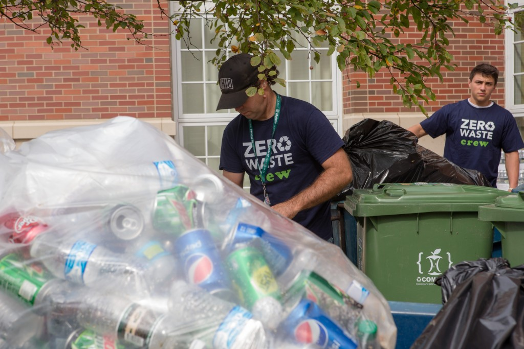 AndrewLadd, Recycling and Zero Waste Manager, and Dyllan Albaugh, a student at Ohio University and volunteer for the Recycling and Zero Waste program, collect  all the recycling material generated before the kick off of the GameDay Recycling Challenge on Saturday, October 15, 2016 in Athens, Ohio. (Jorge Castillo/WOUB)