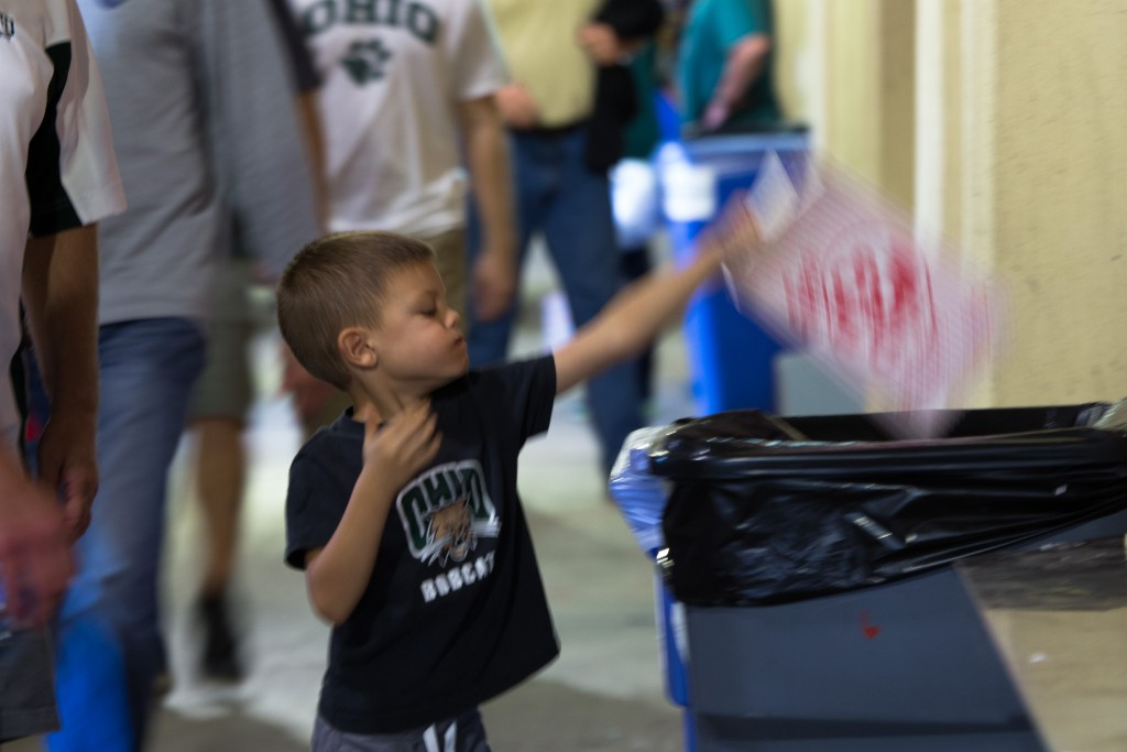Mason Leadbetter, 5, throws away his garbage after the game in the bins located at Door 1 in Peden Stadium on Saturday, October 15, 2016 in Athens, Ohio. All of the garbage collected during this game will be used as part of the numbers for the GameDay Recycling Challenge. (Jorge Castillo Castro/WOUB)