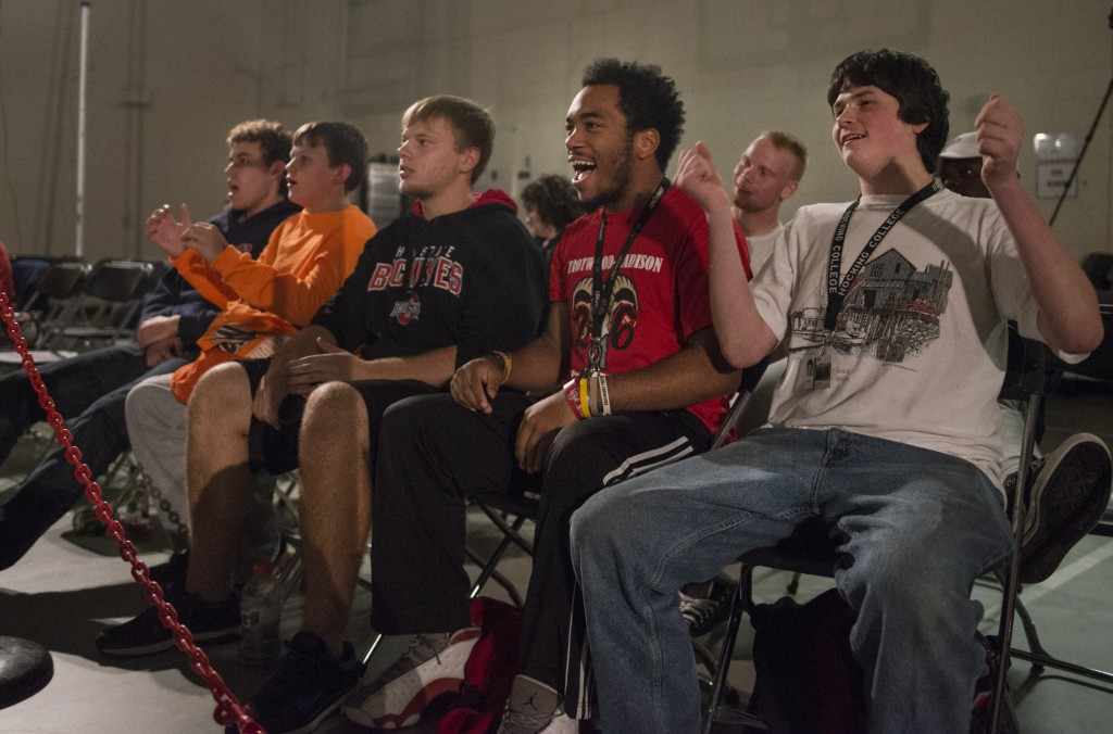 Jeff Lehman, left, Shawn Adams, 13, Justin Householder, Kev Dixon, Will Rose, back, and Josh King cheer and heckle the wrestlers in the Hocking College gymnasium during the XWE Pro Wrestling event on Friday, October 21, 2016 in Nelsonville, Ohio. Hocking College students were admitted into the event free. (Kelsey Brunner/WOUB)
