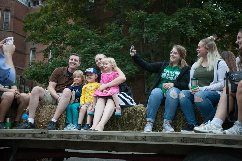 Hayride goers pose for pictures before the begining of the historical hayride tour at the Ridges in Athens, Ohio on Friday, October, 7 2016. (Erin Clark/WOUB)