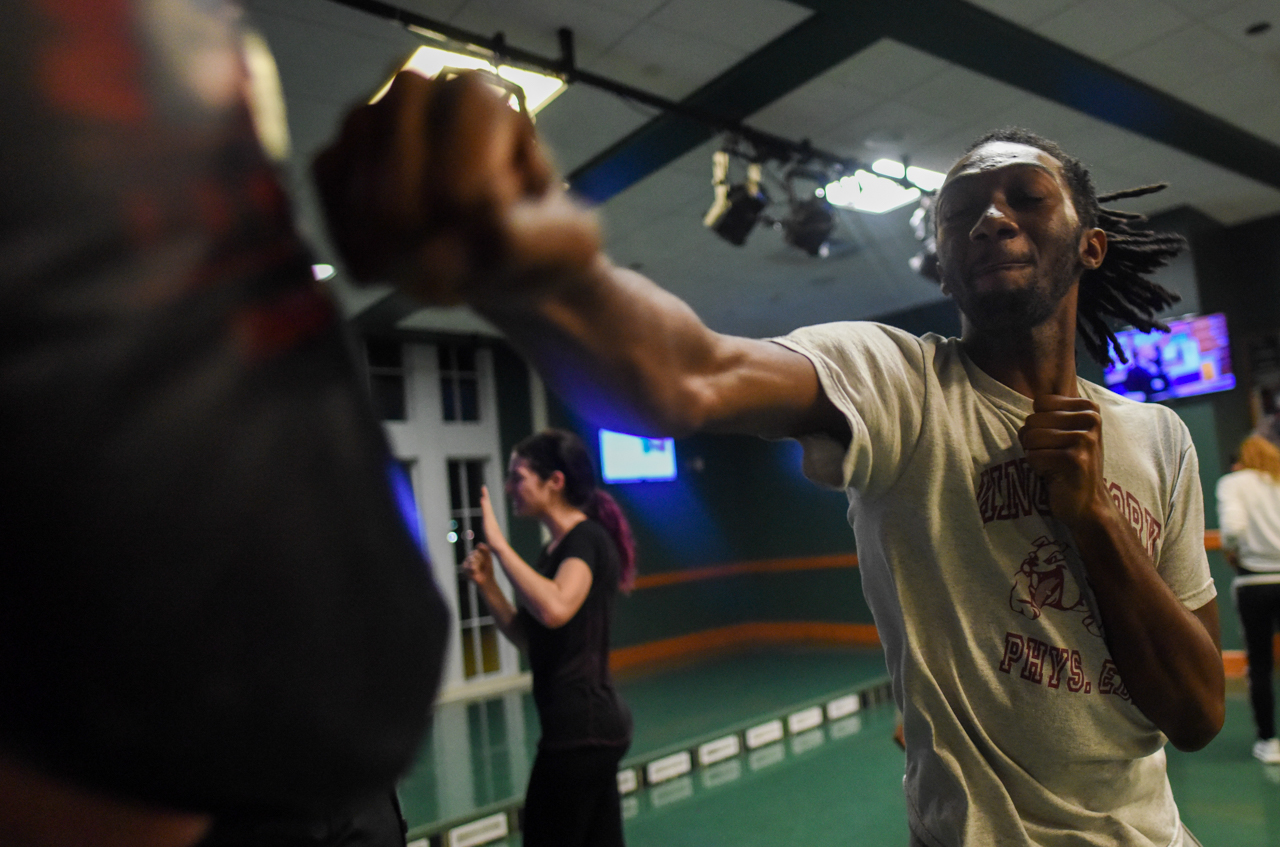 Dontag Graham punching proactive padding during the Queer Self Defense night, sponsored by the Student Senate and LGBT Center, in the Bobcat Lounge in Baker Center at Ohio University on October, 27 2016.  (Carolyn Rogers/WOUB)