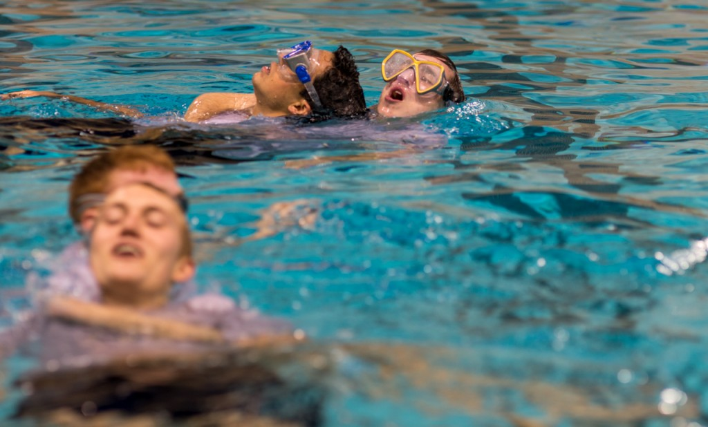 Cadet Ibanez being carried by Cadet Black while training in the pool during the ROTC's Water Survival Lab in the Aquatic center at Ohio University on October, 26,