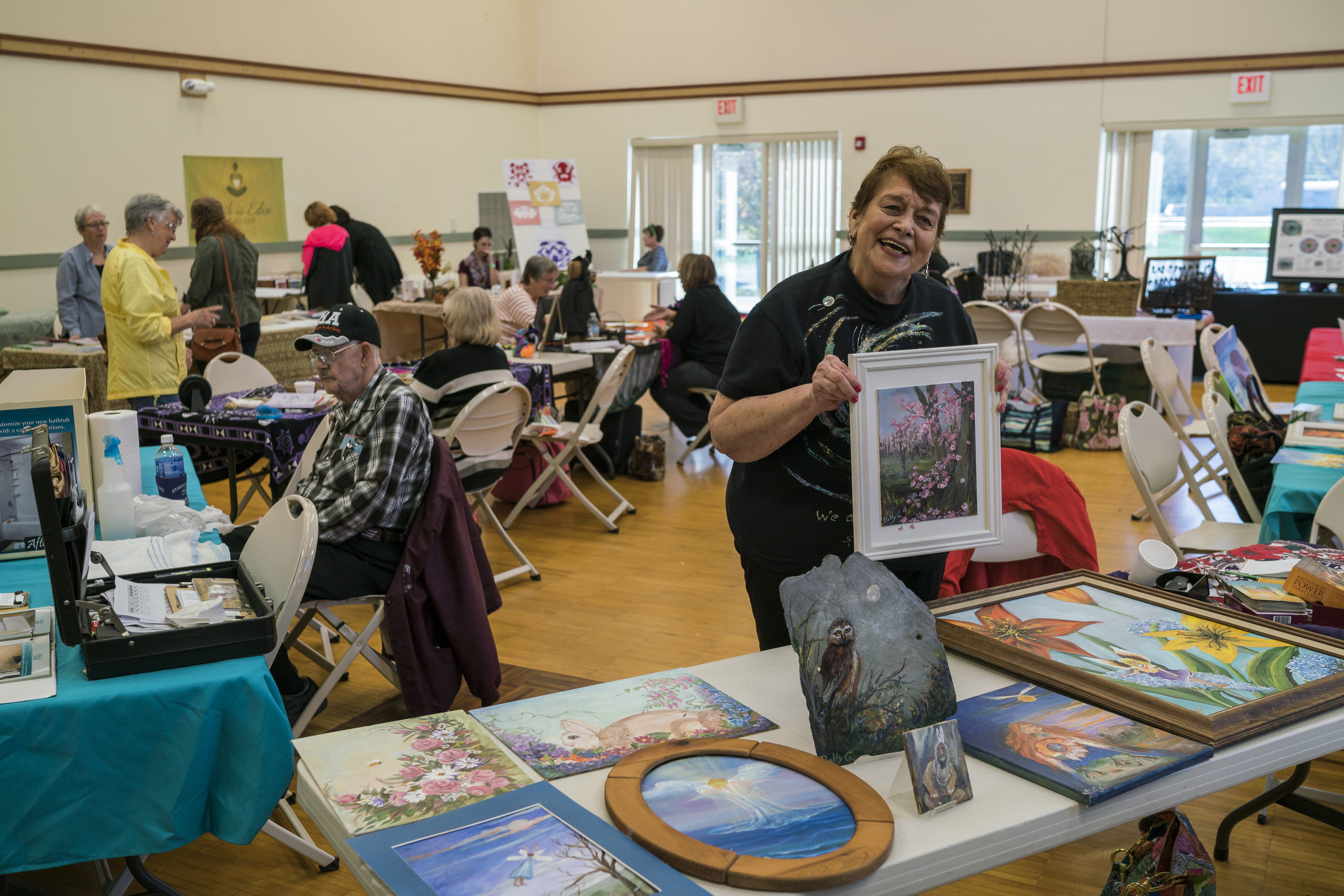 Dolly G. displays her artwork at the Holistic Health and psychic fair on October 29, 2016. (Michael Swensen/WOUB)