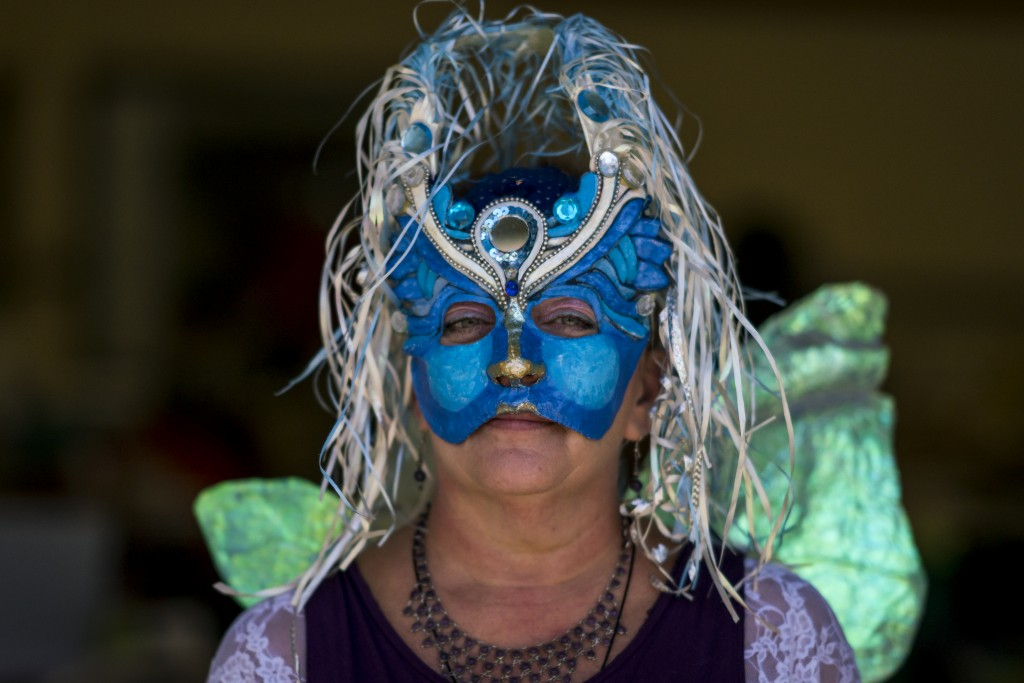 Kay Mackinnon, from Smithville, West Virginia, poses for a portrait at the Holistic Health and Psychic Fair at the Athens Community Center on October 29, 2016. (Michael Swensen/WOUB)