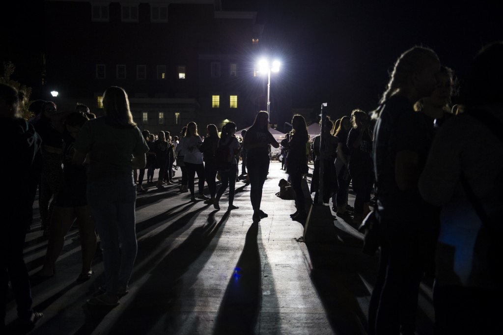 Students stand and wait for the Yell Like Hell event in the Baker Center parking lot at Ohio University on October 6, 2016. (Michael Swensen/WOUB)