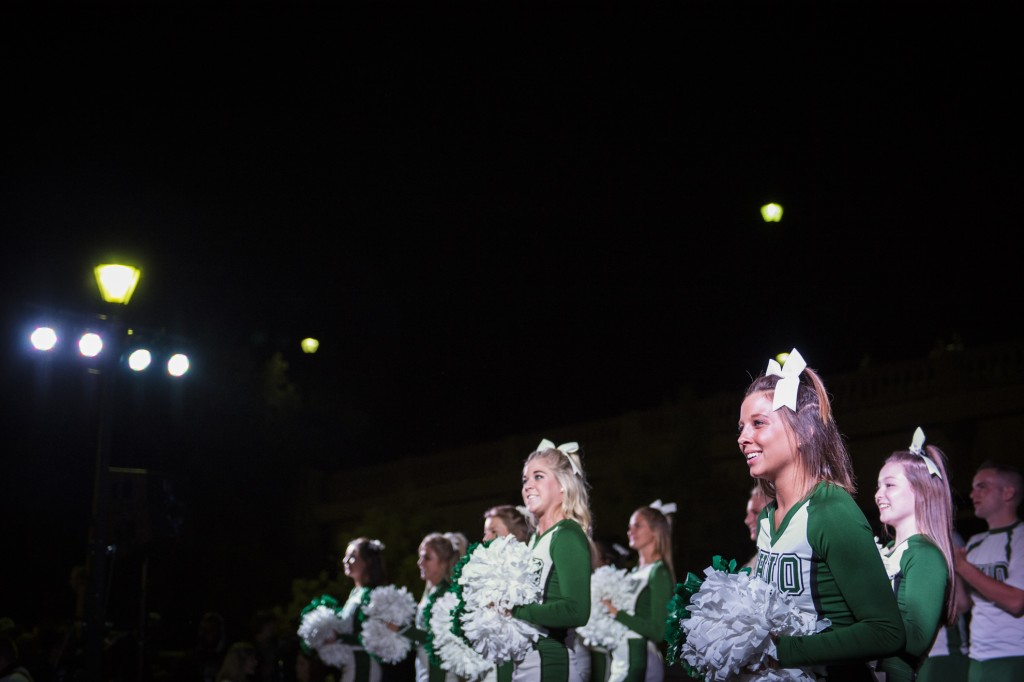 The Ohio University chearleeding squad performs on stage during the Yell Like Hell event at Ohio University on October 6, 2016. (Michael Swensen/WOUB)