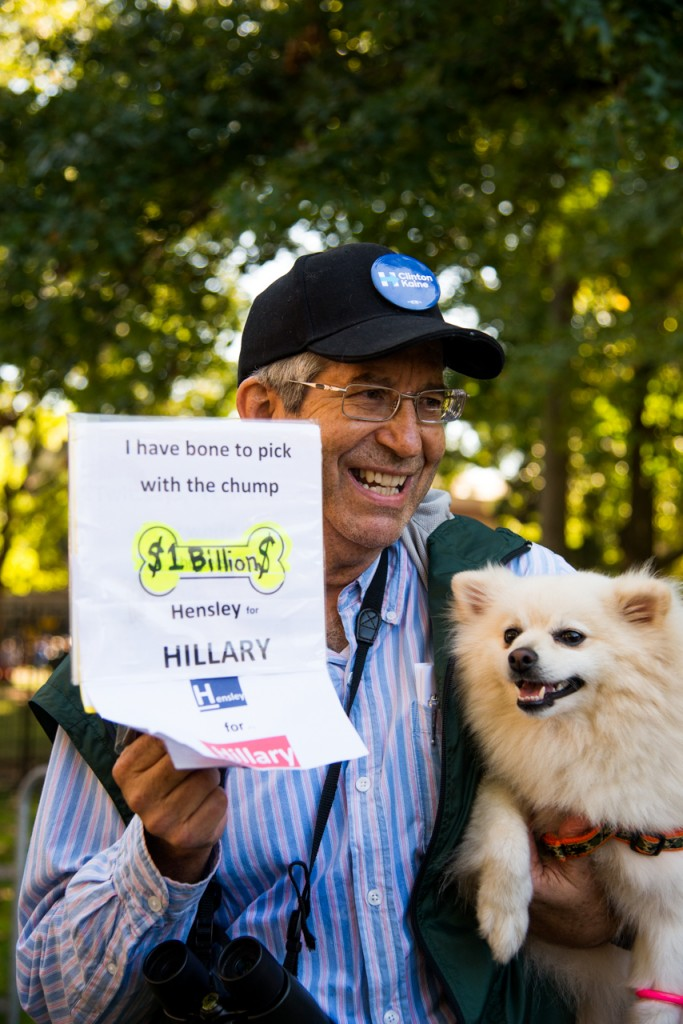 "Clinton Campaign volunteers , Bob Matlott and his Pomeranian dog, Hensley, posing for a portrait at Ohio University in Athens, Ohio, on October 4, 2016. ""Hensley and I have a bone to pick with trump,"" he said. (Carolyn Rogers/ WOUB)"