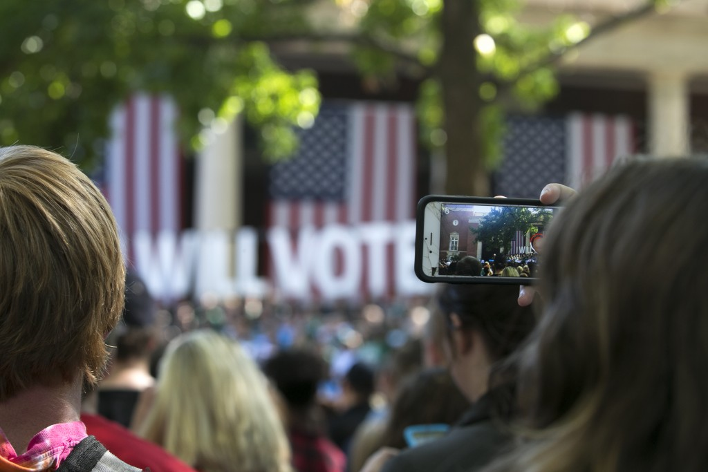 Area residents and OU students gathered on the college green Tuesday to watch and post to their social media the stump speech delivered by Former President Bill Clinton ahead of Tuesday's Vice Presidential debates. (Jennifer Coombes/WOUB)