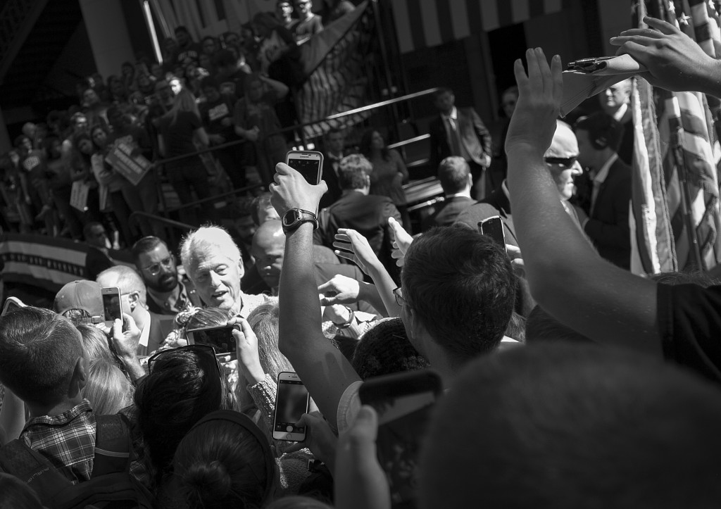 At the end of his speech, Former President Clinton shook hands with people who crowded to the front for selfies, handshakes and photos. (Jennifer Coombes/WOUB)