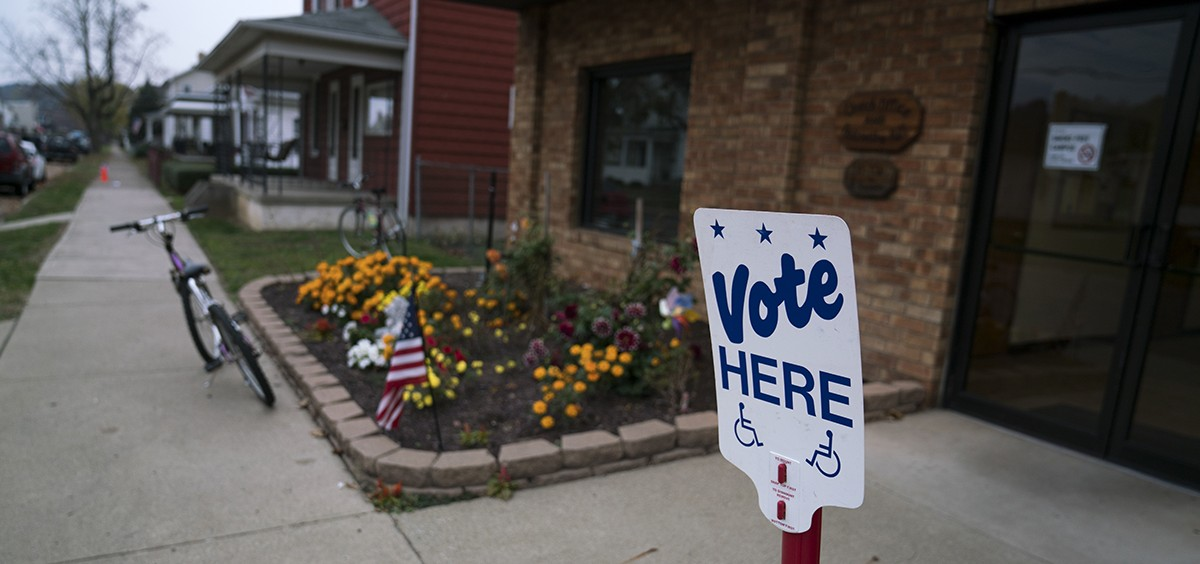 A sign outside of the Nelsonville voter precinct lets people know where they can vote.