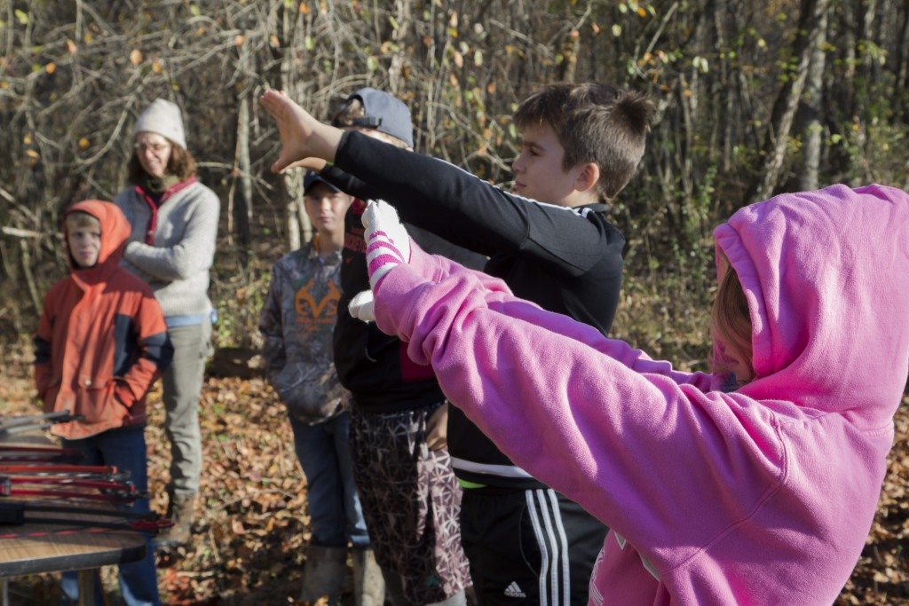 Alexia Hunter, right, and Luke Mullins, left, identify their dominant eye before starting to use the bow and arrow at the Raccoon Creek Partnership Archery Day Camp on Saturday, November 5, 2016, at Waterloo Aquatic Education Center, New Marshfield, Ohio. (Jorge Castillo Castro/WOUB)