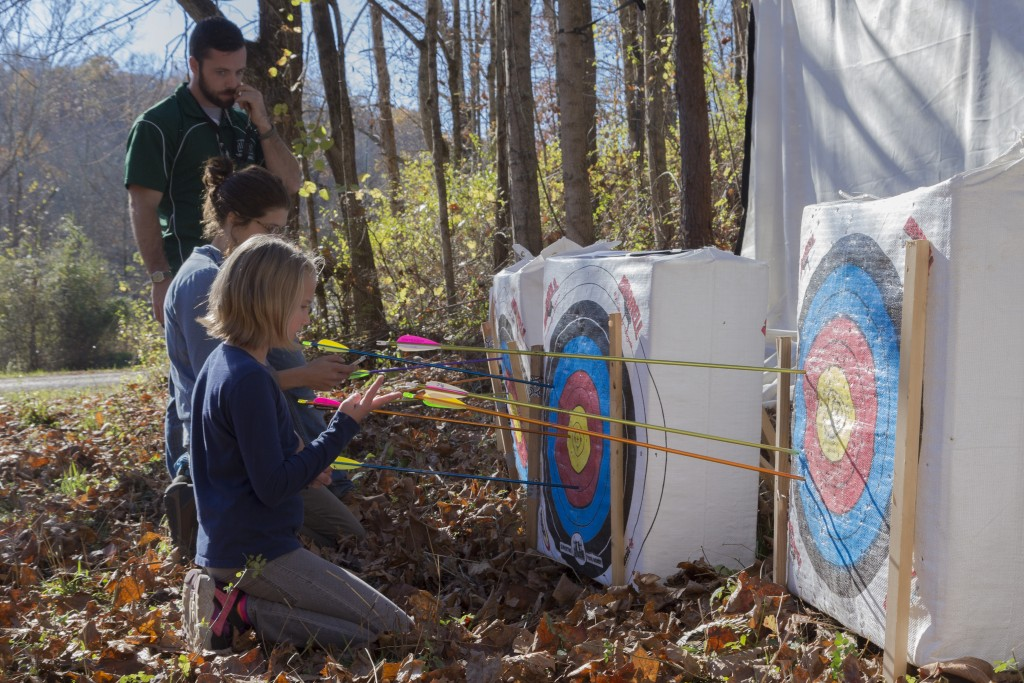 Alexia Hunter, 10 and attendee to the event, remove the arrows from the targets at the Raccoon Creek Partnership Archery Day Camp on Saturday, November 5, 2016, at Waterloo Aquatic Education Center, New Marshfield, Ohio. (Jorge Castillo Castro/WOUB)