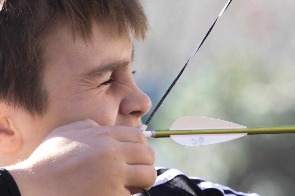 Luke Mullins, attendee to the event, pointing at the target at the Raccoon Creek Partnership Archery Day Camp on Saturday, November 5, 2016, at Waterloo Aquatic Education Center, New Marshfield, Ohio. (Jorge Castillo Castro/WOUB)