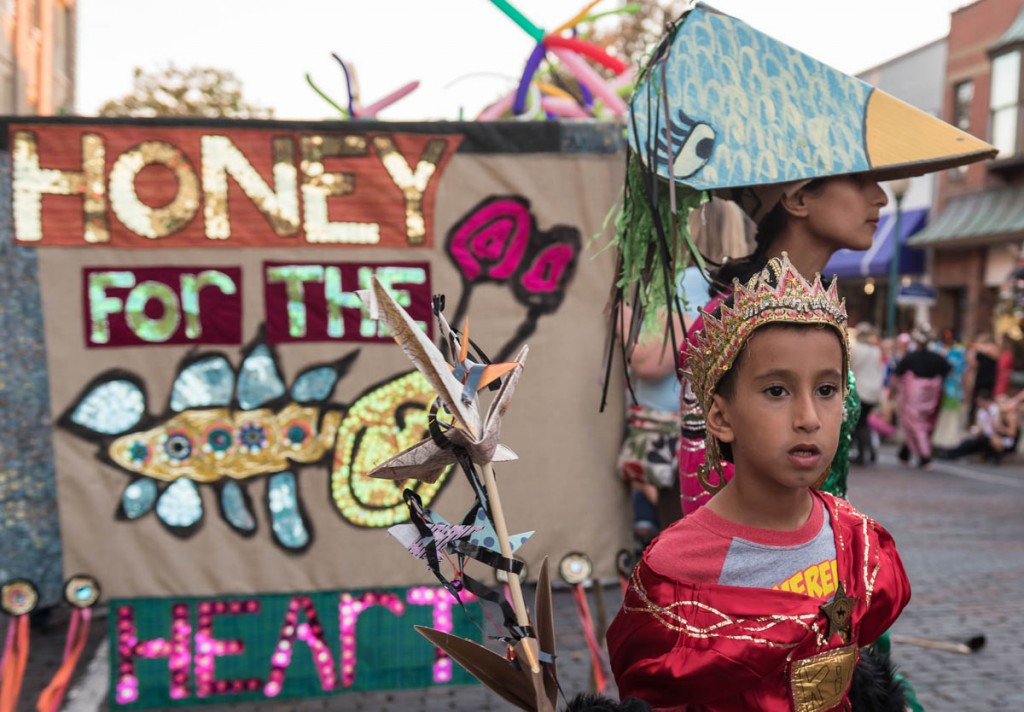 Talal Alshehir, 7 and his mother Fawziah Alshehir lead the Honey for the Heart parade down Court Street in Athens, Ohio on October 29, 2016. The parade is the culmination of weeks of work by volunteers. (Photo by Atish Baidya)