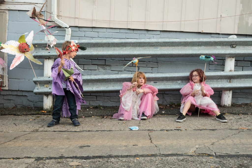 Allegra Gagliano, 9, daughter of Dawn and Mark Gagliano (right); Eleanor Yandrich, 8, daughter of Cynthia Smith and Mike Yandrich (center); and Henry Davis, 5, son of Allison Stone (left); are dressed and ready for the Honey of the Heart parade on October 29, 2016 in Athens, Ohio. (Photo by Atish Baidya)