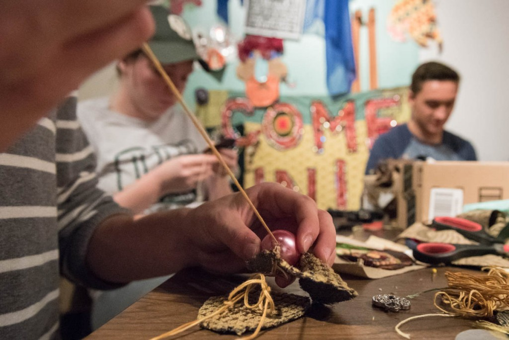 A group of Ohio University students spend time creating decorative elements for the puppets and costumes that will be in the Honey for the Heart parade. The students volunteering their time on October 18, 2016 are part of one of the learning communities at the university. Honey for the Heart partners with different Ohio University learning communities and professors to bring in students to help with make the parade come to life. (Photo by Atish Baidya)