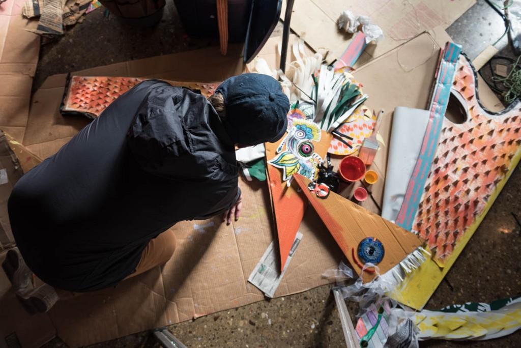 Andrew Riordan, of Cincinnati, Ohio, and an Ohio University senior studying graphic design, paints cardboard headpieces on October 26, 2016. (Photo by Atish Baidya)