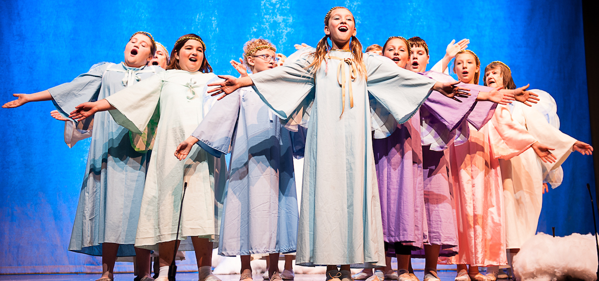 """A group of angels proclaim """"It's a heavenly day in heaven!"""" Left to right: Cali Papineau, Joe Balding (partial), Jozlyn Bew, Fox Thompson, Tatum L'Heureux, Izzy Meek, Abram Papineau, Jailee LaFleur, Sylvia Abbott. (Submitted)"""
