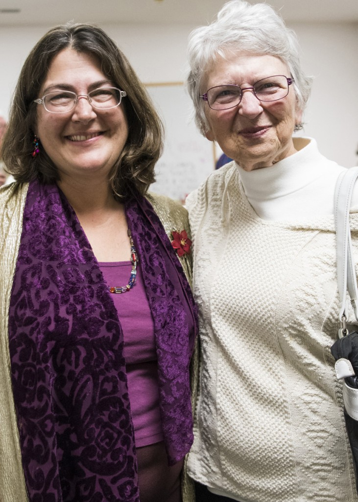 Recently named Rural Action Development Director Debbie Phillips, left, poses for a picture with Rural Action long-time member Mary Anne Flournoy, right, on December 13, 2016. (Robert McGraw/WOUB)