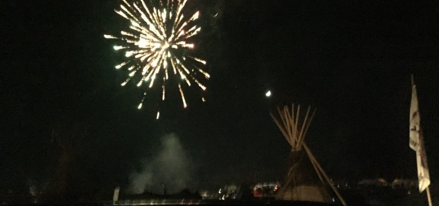 Fireworks go off above the Dakota Access Pipeline site after it is announced that the U.S. Army Corps of Engineers has denied an easement for the pipeline.  Photo courtesy of Joe DePalma