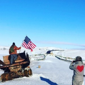 Joe Depalma, left, places a flag in a truck, along the road where security was stationed. Photo courtesy of Joe DePalma