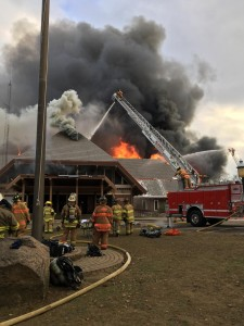 Firefighters battle a blaze at Hocking Hills Dining Lodge on Thursday. Multiple fire departments were called to fight the fire, which destroyed the building. Photo courtesy of the Ohio Department of Natural Resources