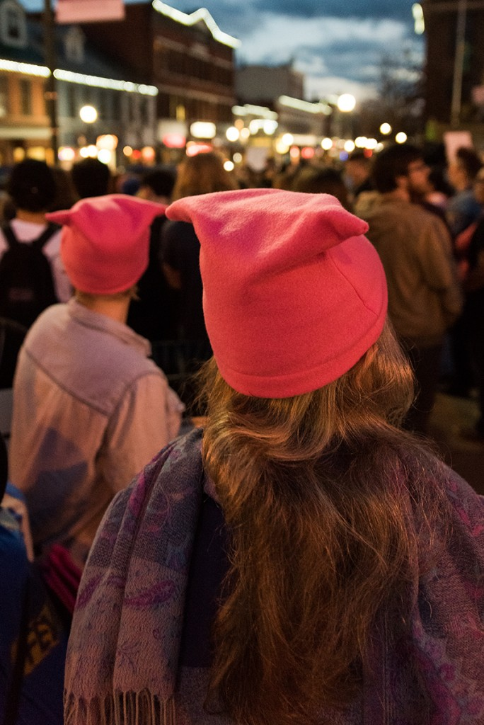 Wenda Sheard, right, and Lavena Staten, left, wear their pink hats at the Athens Women's March gathering outside of the Athens County courthouse on January 20, 2017. (Nickolas Oatley/WOUB)