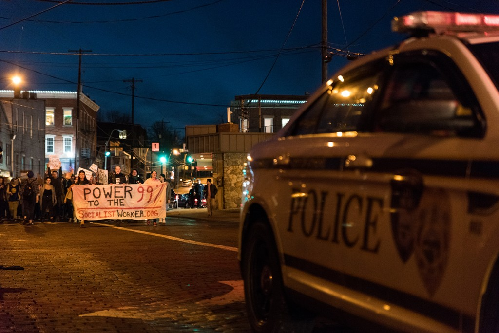 Athens City police officers block traffic at the Mill Street intersection on campus to clear the way for the Athens Women's March on January 20, 2017. (Nickolas Oatley/WOUB)